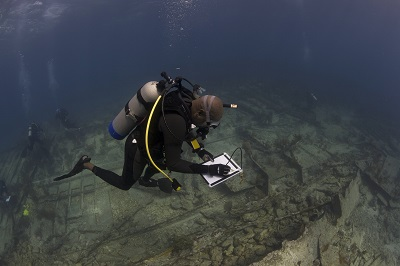 A DWP diver surveys the Hannah M. Bell shipwreck on Elbow Reef, Key Largo, Florida. Credit: Diving with a Purpose.
