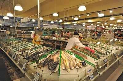Buford Highway Farmers' Market in Doraville, Georgia. Licensed under CC BY 2.0 via Wikimedia Commons.  Just outside Atlanta, Buford Highway boasts a high concentration of businesses owned by and catering to immigrant communities, including Chinese, Vietnamese, Korean, and Mexican restaurants and groceries. Its farmers' market is internationally renowned. Credit: Southern Foodways Alliance—Flickr: HaroldShinn,