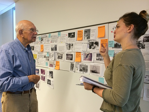 Harry O. Larson, one of the Gallaudet 11, reviews a draft exhibition script with CDDS intern Maggie Kopp. Credit: Brian H. Greenwald