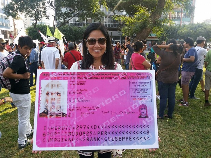 Professor María Eugenia Ulfe (Pontifical Catholic Univ. of Peru) holds up an enlarged ID card created by Peruvian artist and activist Giuseppe Campuzano (1969–2013) during an April 2014 rally in support of gay marriage in Lima. The ID belongs to Campuzano's DNI (De Natura Incertus) collection in Museo Travesti del Perú. Karen Bernedo