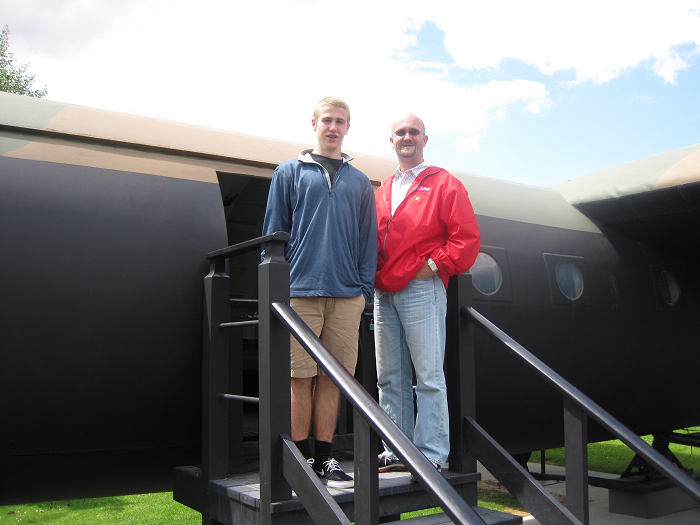 Sam Spare and Kevin Wagner outside the Memorial Pegasus Museum in Normandy with a restored glider like the one William T. McCabe would have flown in World War II