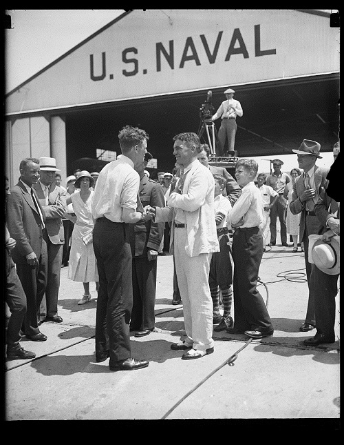Charles Lindbergh (center left) at a US naval hangar: The USHMM is asking citizen historians to conduct research on a variety of historical topics related to the Holocaust, including Lindbergh's famous 1941 speech in Des Moines, Iowa. Credit: Harris & Ewing Collection (Library of Congress)
