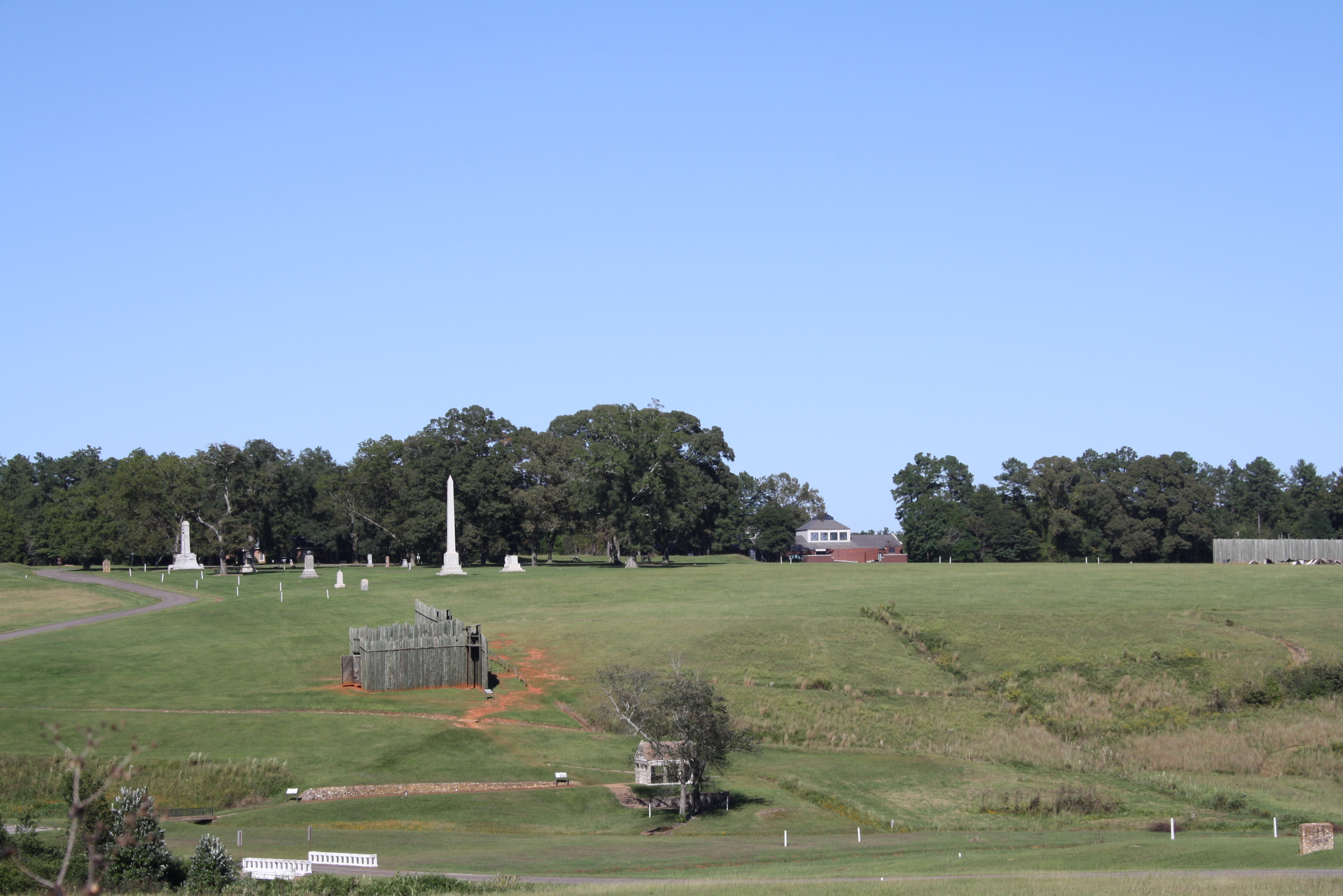 The prison site at Andersonville is adjacent to the National Prisoner of War Museum (shown in the background) and about one-third of a mile from the national cemetery (not shown). Andersonville National Historic Site