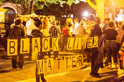 Black Lives Matter protesters at the Minnesota Governor's Mansion in July 2016. Archivists at DocNow work with community activists to document the offline labor that makes social media hashtag campaigns such as #BlackLivesMatter possible. Tony Webster/Flickr/CC BY-SA 2.0