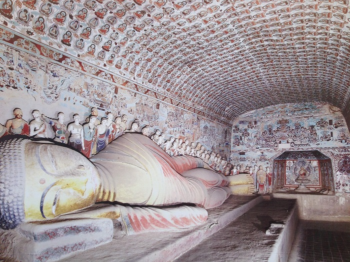 A 55-foot reclining Buddha statue from the Tang period rests in Cave 148 of the Mogao Caves. Krister Blomberg/Wikimedia Commons