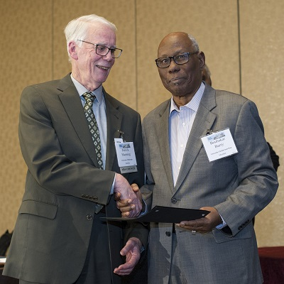 AHA president Patrick Manning congratulates 2016's Honorary Foreign Member, the eminent historian of Senegambia Boubakar Barry, at the Awards Ceremony.