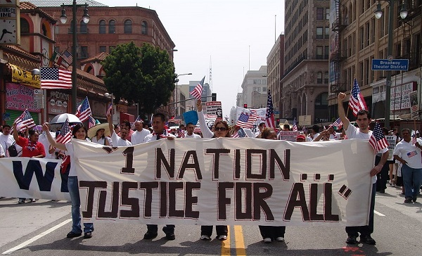 Immigrant-rights advocates march in downtown Los Angeles on May Day, 2006. This image is the backdrop of the #ImmigrationSyllabus homepage. Jonathan McIntosh/via Wikimedia Commons