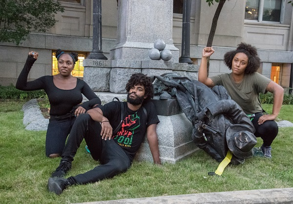 Activists in Durham with the toppled Confederate soldier statue. Rodney Dunning/Flickr/CC BY-NC-ND 2.0. Image cropped.