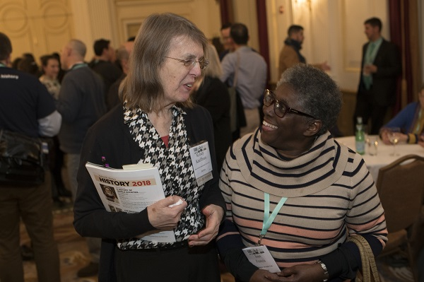 Award winner Kelsey Kauffman (left; Indiana Women's Prison) and Joan Francis (Washington Adventist Univ.) share a laugh at the Welcome Reception.