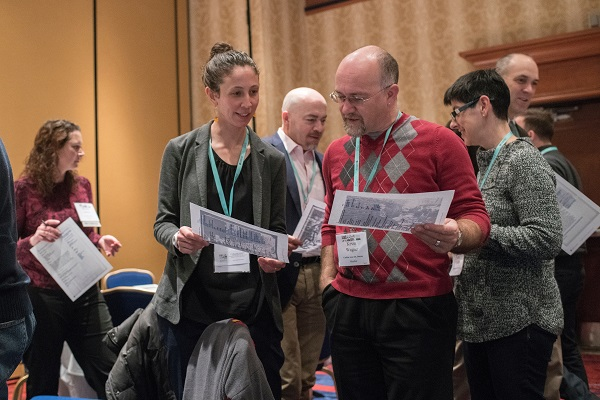 Robin Kietlinksi (LaGuardia Community Coll.) and Kevin Wagner (Carlisle Area Sch. District) confer about teaching World War I at the K–16 Educators Workshop.