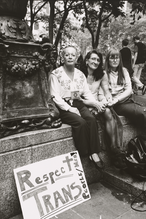 "Sylvia Rivera, a trans activist, sits between her partner Julia Murray (<span class=""CharOverride-34"">right</span>) and Christina Hayworth at the 2000 Pride Parade in New York City. Luis Carle/National Portrait Gallery/Smithsonian Institution; acquisition made possible through the Smithsonian Latino Initiatives Pool, administered by the Smithsonian Latino Center"