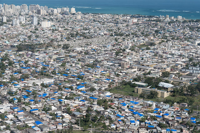 Blue tarps visible on the roofs of buildings in San Juan, Puerto Rico. The tarps were installed by the US Army Corp of Engineers as part of the Federal Emergency Management Agency's (FEMA) program Operation Blue Roof. Lori Shaull/CC BY-SA 2.0/via Flickr
