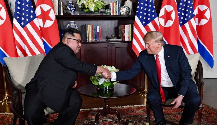US President Donald Trump and North Korean Supreme Leader Kim Jong Un shake hands at a summit meeting between the countries on June 12, 2018.