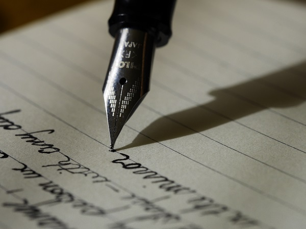 a fountain pen writing a letter