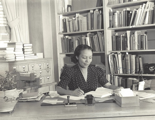 Dorothy Porter in 1939, at her desk in the Carnegie Library at Howard University.