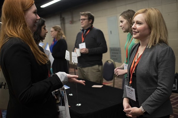 Lindsey Martin, assistant director of postdoctoral affairs at Northwestern Univ., speaks to an AHA19 attendee at the AHA Career Fair.