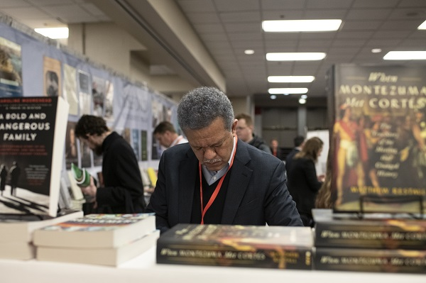 Browsing books in the Exhibit Hall.