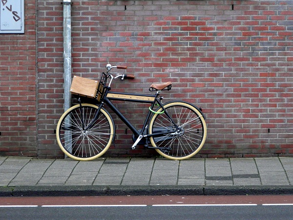 A bicycle against a brick wall.