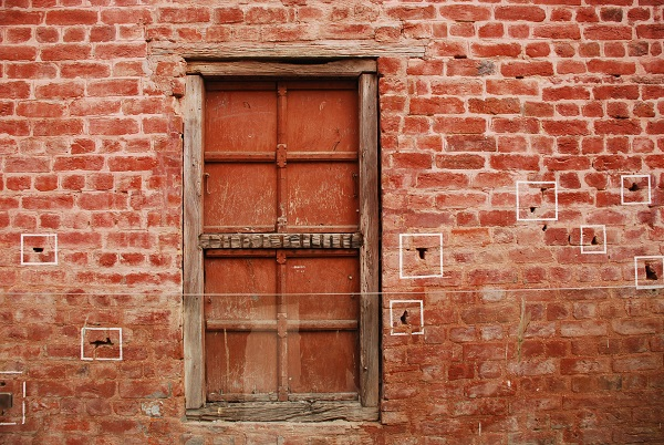 White boxes enclose bullet holes left by General Dyer's troops in the walls of the Jallianwala Bagh in Amritsar, Punjab.