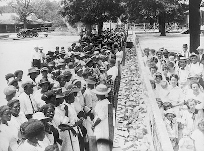 Segregated crowds attend a barbecue at an Alabama plantation.