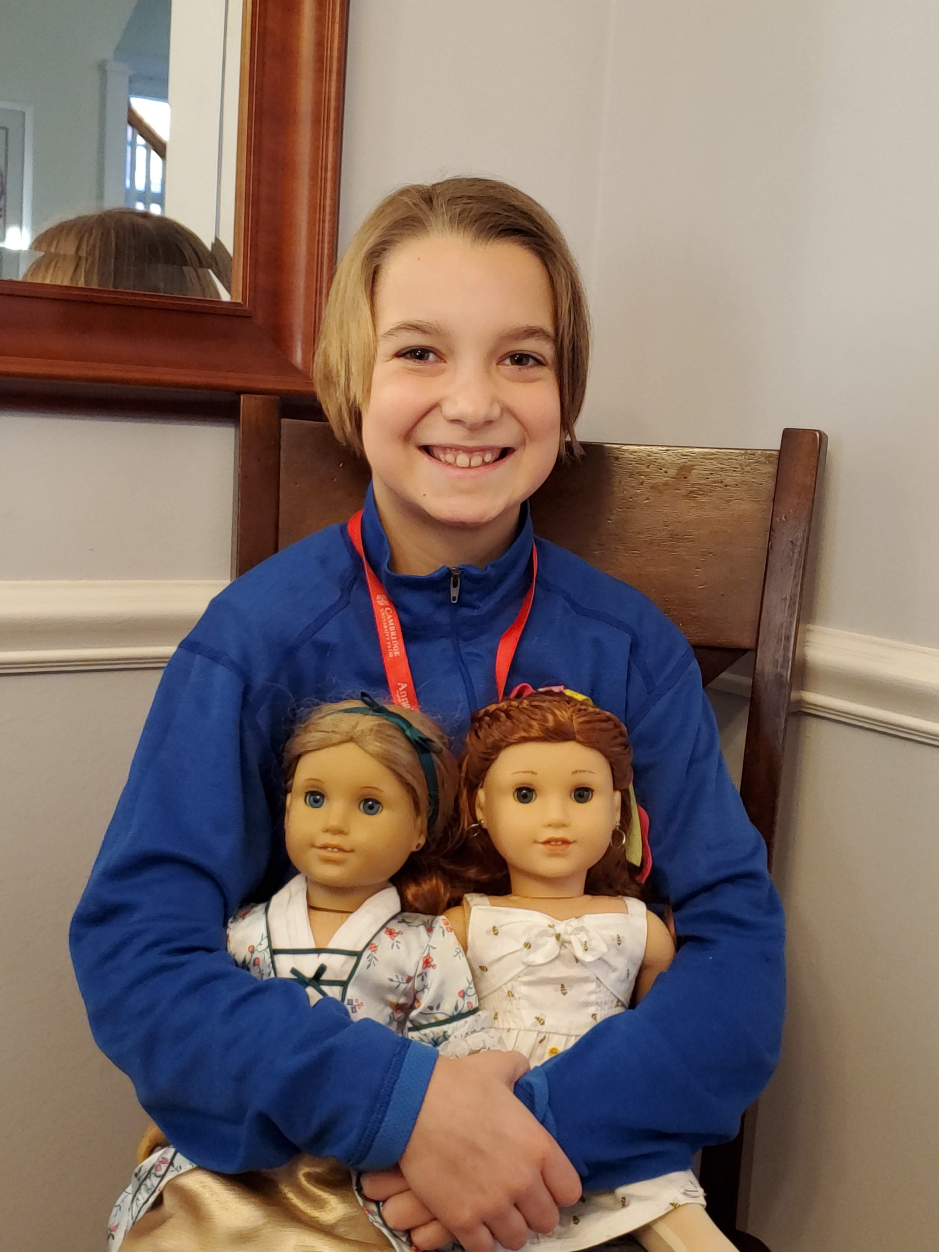 One attendee poses with her American Girl dolls, Elizabeth and Blair.