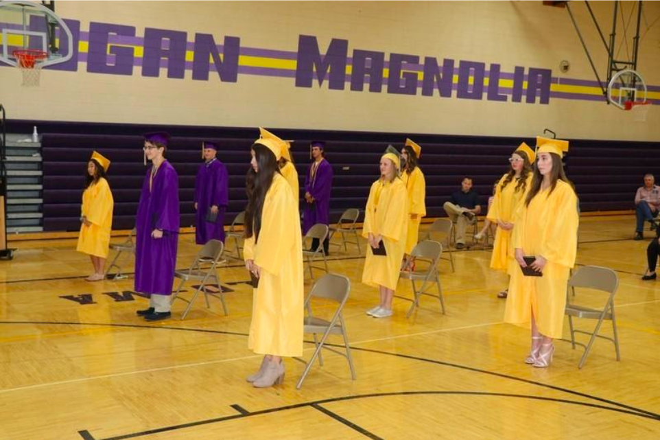 JOTPY captures fleeting moments that reveal the social changes wrought by COVID-19. Here, 2020 graduates at Logan-Magnolia School (Logan, Iowa) practice for graduation.