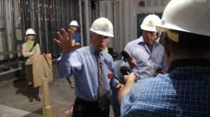NMAH Director John L. Gray leads the hard-hat tour of the construction zone.