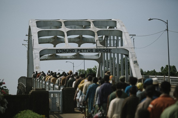 Marchers cross the Edmund Pettus Bridge in SELMA, from Paramount Pictures, Pathé, and Harpo Films.