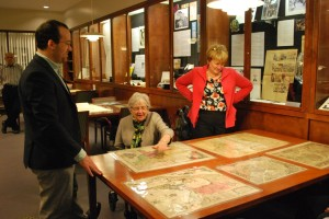John Nelson shows a donor the Stuckenberg Map Collection in Gettysburg College's Special Collections.