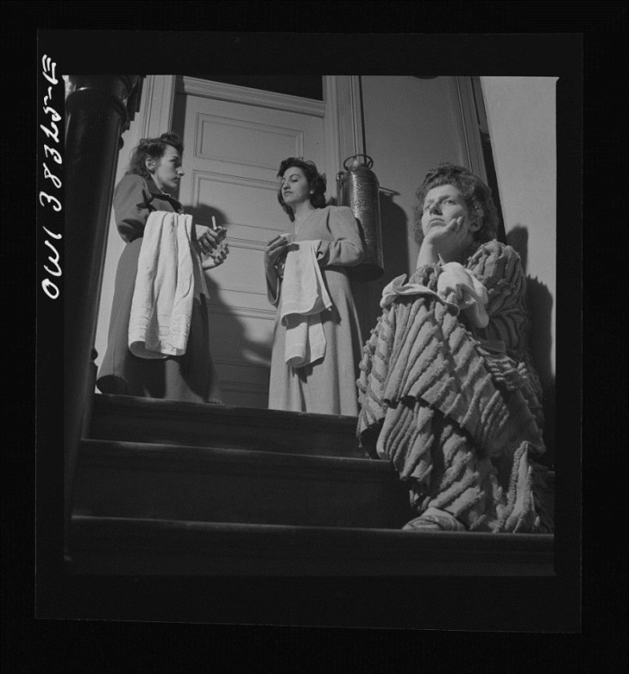 Esther Bubley photographed her sister, Enid Bubley, with two other women at Dissin's boarding house in January 1943. The photograph is now housed by the Library of Congress Prints and Photographs Division.