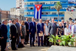 US secretary of state John Kerry (center left) stands for the Cuban national anthem at the recently reopened US embassy in Havana, Cuba (August 14, 2015). Wikimedia Commons