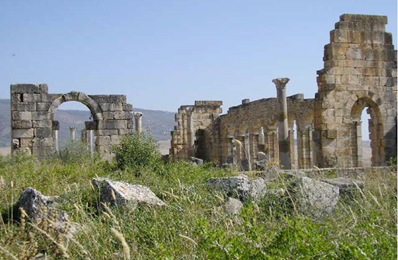 The Roman ruins of Volubilis near Moulay Idriss. A portion of the Capitoline temple can be seen at left. Photograph courtesy of author.
