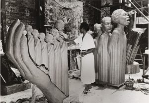 Augusta Savage at work on her famous sculpture, The Harp, commissioned by the 1939 World's Fair in New York City. New York Public Library Digital Collections