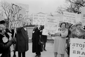 Women protest against the Federal Equal Rights Amendment in front of the White House, 1977. Library of Congress