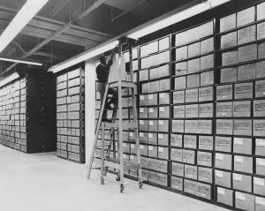 An employee services records in the Washington National Records Center stack area. Conducting historical research taught Stephanie Fulbright the skills to analyze varied sources and produce comprehensible results. US National Archives
