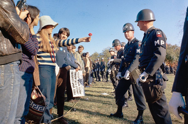 A protestor offers a flower to police during an anti-Vietnam War demonstration at the Pentagon in October 1967.