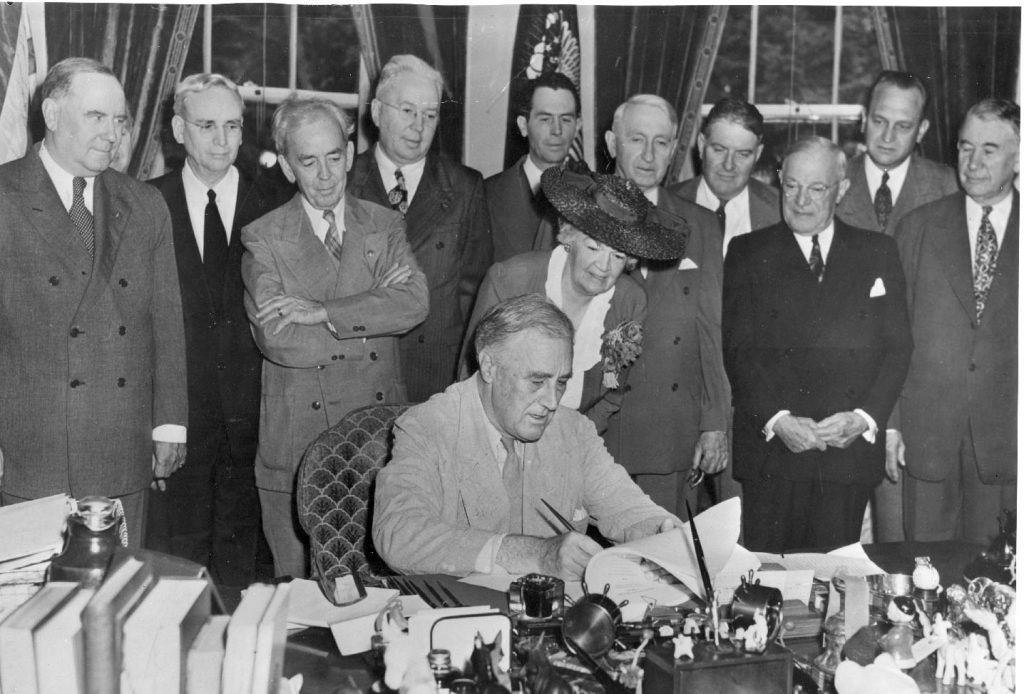 President Roosevelt signs the Servicemen's Readjustment Act of 1944, or the GI Bill.