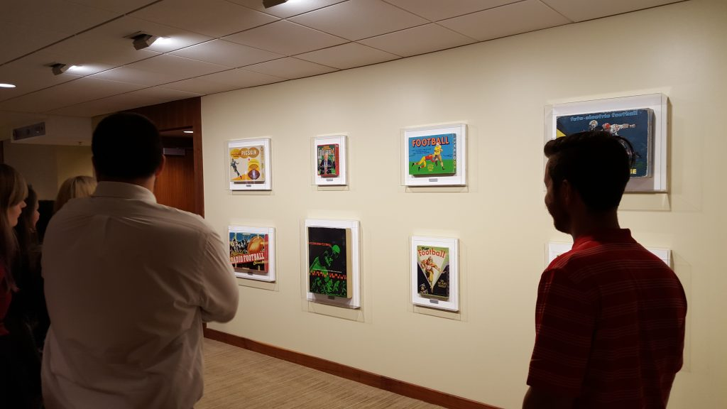 Students discuss Tim Liddy's Circa Series during a tour of the collection at the Kansas City Chiefs football stadium.