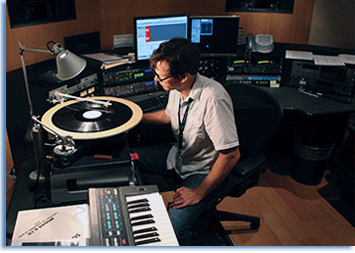 "An audio engineer monitors the playback of a 16"" lacquer disc. Library of Congress Photo/Abby Brack Lewis."