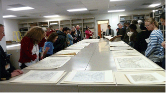 Alan Jutzi, Avery chief curator, rare books, provides participants with a guided tour through some of the rare volumes of maps in the library's collection. Photo by Robert B. Townsend.