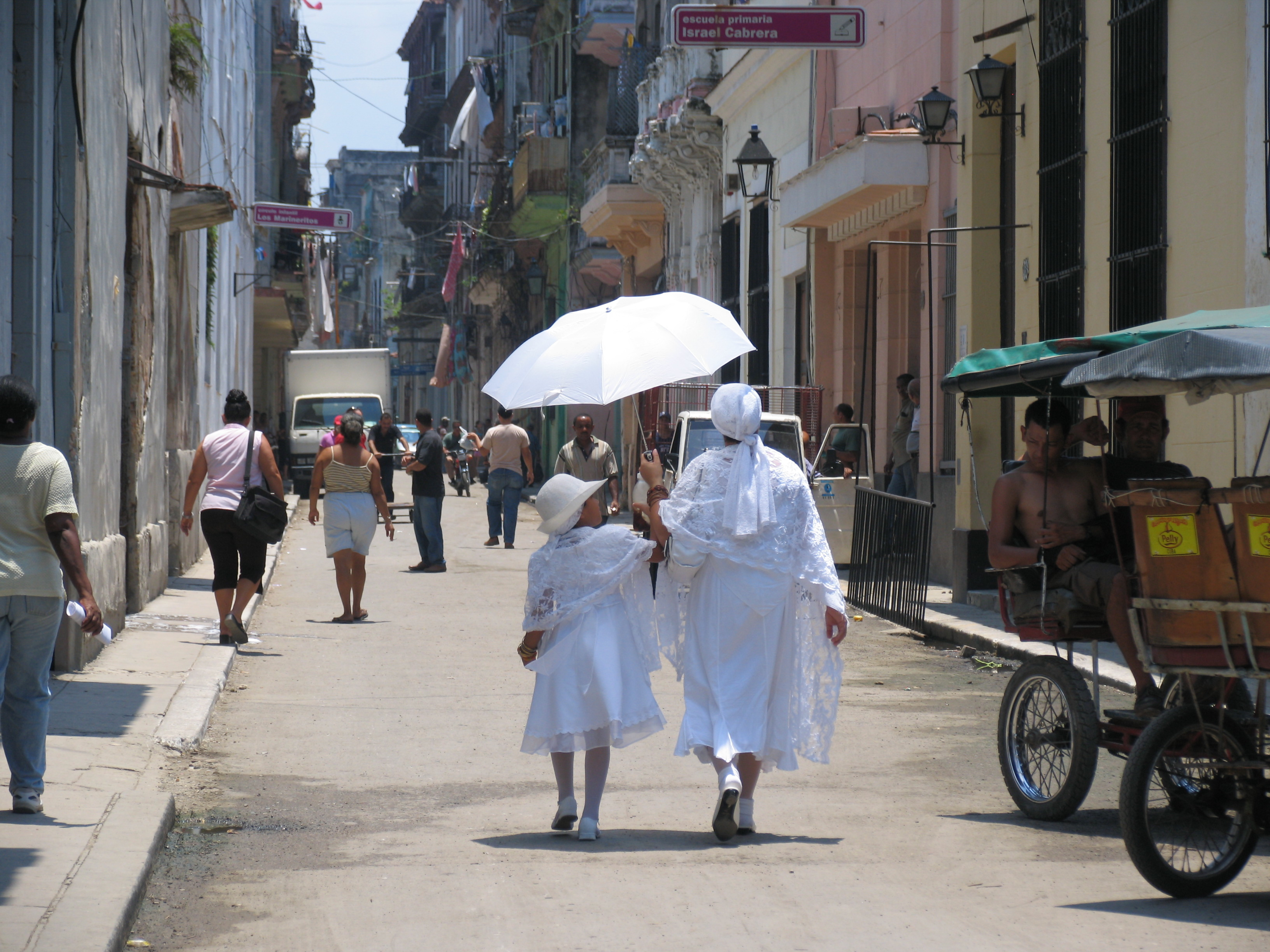Photo © Lillian Guerra. A grandmother and granddaughter dressed as yabós, as part of their baptismal and ritual entry into the Santería faith, Old Havana, Cuba, 2011. After decades of repression of Santería, the main Afro-Cuban religion, the Cuban government's lifting of sanctions against its practice has revitalized it enormously. Multiple generations are now rediscovering their black identities through the religion their ancestors used to help them survive slavery.