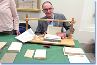 A NARA specialist in book preservation demonstrates some of the tools of the trade for the public at the recent Preservation EXPOsed! event.