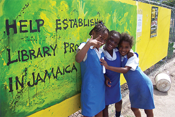 Three students ready for their afternoon at the HELP Jamaica! education center. Photo courtesy of HELP Jamaica.