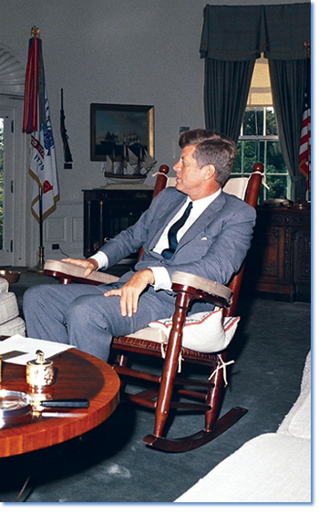 JFK in his rocking chair. Photograph by Robert Knudsen, from the John F. Kennedy Presidential Library and Museum, Boston (orig. date: 08/15/1963).
