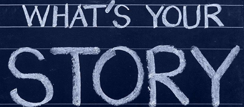 "A chalkboard with the text ""What's your Story"""